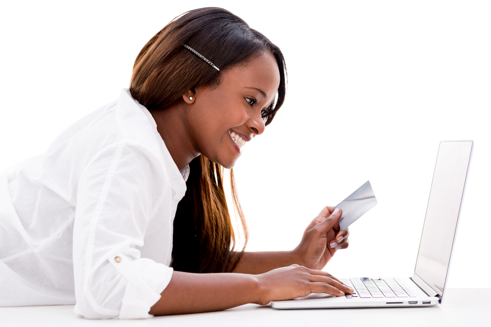 Woman paying online with a credit card - isolated over white